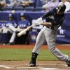 San Diego Padres\' Yonder Alonso swings at a pitch during an exhibition baseball game against the Texas Rangers, Saturday, March 30, 2013, at the Alamodome in San Antonio. Texas won 5-2. (AP Photo/Darren Abate)