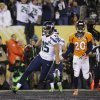 Seattle Seahawks\' Jermaine Kearse (15) scores on a 23-yard touchdown reception in front of Denver Broncos\' Mike Adams (20) during the second half of the NFL Super Bowl XLVIII football game Sunday, Feb. 2, 2014, in East Rutherford, N.J. (AP Photo/Matt Slocum)