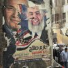A defaced poster of Presidential candidate for the upcoming elections Ahmed Shafiq, left, and disqualified Egyptian presidential hopeful Muslim cleric Hazem Salah Abu Ismail in Cairo, Egypt, Thursday, April 26, 2012. Egypt\'s election commission announced the final list of 13 candidates this week for next month\'s presidential elections. Arabic on the poster reads,