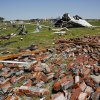 Brick from a destroyed house in Union City are spread across the lawn on Saturday, June 1, 2013. Photo by Jim Beckel, The Oklahoman.