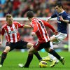 Tottenham Hotspur\'s Gareth Bale, right, vies for the ball with Sunderland\'s Craig Gardner, center, and Sebastian Larsson, left, during their English Premier League soccer match at the Stadium of Light, Sunderland, England, Saturday Dec. 29, 2012. (AP Photo/Scott Heppell)