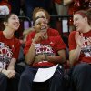 Photo - CORRECT ROUND THEY WILL PLAY IN THE TOURNAMENT - Nebraska's Rachel Theriot, left, Brandi Jeffery, center, and Jordan Hooper, right, react after they hear their assignment at the NCAA college basketball tournament during a live television broadcast in Lincoln, Neb., Monday, March 17, 2014. Nebraska will play in the first round against Fresno State in Los Angeles. (AP Photo/Nati Harnik)