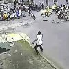 In this image taken from video and provided Monday, May 13, 2013, by the New Orleans Police Department, a possible shooting suspect in a white shirt, bottom center, shoots into a crowd of people, Sunday in New Orleans. Police believe more than one gun was fired in the Mother\'s Day gunfire that wounded 19 people during a New Orleans neighborhood parade. (AP Photo/New Orleans Police Department)