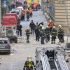 Firefighters and rescue workers work at the scene of a strong blast in a building in the center of Prague, Czech Republic, in the morning on Monday, April 29, 2013. A powerful explosion badly damaged an office building in the center of the Czech capital Monday, injuring up to 40 people. Authorities believe people may still be buried in the rubble. (AP Photo/CTK, Michal Dolezal)