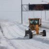 A road grader removes snow from a lane of traffic on westbound Interstate 40. Traffic on the interstate was extremely light Tuesday. A severe winter storm created whiteout conditions and caused snow drifts that made problems for the few motorists who ventured out Tuesday afternoon, Feb. 1, 2011. Photo by Jim Beckel, The Oklahoman