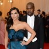 """Kim Kardashian, left, and Kanye West attend The Metropolitan Museum of Art\'s Costume Institute benefit gala celebrating """"Charles James: Beyond Fashion"""" on Monday, May 5, 2014, in New York. (Photo by Evan Agostini/Invision/AP)"""