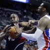 Photo - Atlanta Hawks forward Elton Brand (42) drives to the basket against Detroit Pistons center Andre Drummond, right, during the first half of an NBA basketball game Friday, Feb. 21, 2014, in Auburn Hills, Mich. (AP Photo/Duane Burleson)