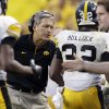 Photo -   Iowa head coach Kirk Ferentz celebrates with running back Andre Dawson (32) after Dawson scored a touchdown during the second half of an NCAA college football game against Northern Illinois at Soldier Field in Chicago, Saturday, Sept. 1, 2012. Iowa won 18-17. (AP Photo/Nam Y. Huh)
