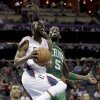 Charlotte Bobcats\' Kemba Walker, front, drives past Boston Celtics\' Kevin Garnett, rear, during the first half of an NBA basketball game in Charlotte, N.C., Monday, Feb. 11, 2013. (AP Photo/Chuck Burton)