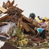 Neighbors pitch in to help recover items out of the home of Scott and M\'Lynn McCann\'s home that was destroyed by a tornado west of El Reno, Tuesday, May 24, 2011. Photo by Chris Landsberger, The Oklahoman ORG XMIT: KOD