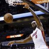Photo - Miami Heat forward LeBron James dunks against the Chicago Bulls during the first half of Game 2 of their NBA basketball playoff series in the Eastern Conference semifinals, Wednesday, May 8, 2013, in Miami. (AP Photo/Lynne Sladky)