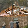 A house in Tioga, La., is severely damaged after an apparent tornado tore through the area Tuesday, Dec. 25, 2012. (AP Photo/The Daily Town Talk, Melinda Martinez) NO SALES