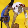 Photo -   Oklahoma City Thunder point guard Russell Westbrook (0) and Miami Heat small forward Shane Battier (31) go after a rebound during the first half at Game 3 of the NBA Finals basketball series, Sunday, June 17, 2012, in Miami. (AP Photo/Mike Segar, Pool)