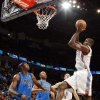 Oklahoma City\'s Serge Ibaka (9) looks to score in front of Brendan Haywood (33) and Caron Butler (4) of Dallas next to Oklahoma City\'s Nick Collison (4) during the NBA basketball game between the Dallas Mavericks and the Oklahoma City Thunder at the Oklahoma City Arena in Oklahoma City, Monday, Dec. 27, 2010. Photo by Nate Billings, The Oklahoman