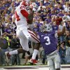 Oklahoma Sooners\' Dejuan Miller (24) catches a touchdown over Kansas State Wildcats\' Allen Chapman (3) during the college football game between the University of Oklahoma Sooners (OU) and the Kansas State University Wildcats (KSU) at Bill Snyder Family Stadium on Sunday, Oct. 30, 2011. in Manhattan, Kan. Photo by Chris Landsberger, The Oklahoman ORG XMIT: KOD