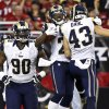 Photo -   St. Louis Rams' Janoris Jenkins, center, celebrates his interception returned for a touchdown against the Arizona Cardinals with Craig Dahl (43) and Michael Brockers (90) during the second half of their NFL football game, Sunday, Nov. 25, 2012, in Glendale, Ariz. The Rams won 31-17. Jenkins became the first player in Rams history and the first NFL rookie since 1960 to return two interceptions for touchdowns in the same game. (AP Photo/Ross D. Franklin)