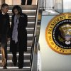 President Barack Obama and first lady Michelle Obama walk off Air Force One after arriving at O\'Hare International Airport in Chicago, Tuesday, Nov. 6, 2012. (AP Photo/Paul Beaty)