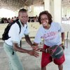 Photo - Danielle Robinson, right, and the Sooners helped out at the Mission of Hope in Haiti. Photo Provided