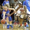 Photo - Louisville's Shawnta' Dyer, right, battles SMU's Korina Baker for a loose ball during the first half of an NCAA college basketball game Sunday Dec. 29, 2013, in Louisville, Ky. (AP Photo/Timothy D. Easley)