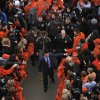 Oklahoma State coach Mike Gundy walks through fans during the Spirit Walk before the Bedlam college football game between the Oklahoma State University Cowboys (OSU) and the University of Oklahoma Sooners (OU) at Boone Pickens Stadium in Stillwater, Okla., Saturday, Dec. 3, 2011. Photo by Bryan Terry, The Oklahoman