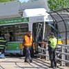 Photo - A Massachusetts Bay Transportation Authority bus hangs over the Massachusetts Turnpike after crashing on Centre Street in Newton, Mass., Sunday, May 18, 2014. Seven passengers and the bus driver were transported to a hospital with non-life-threatening injuries, MBTA spokeswoman Kelly Smith. Three other passengers declined medical treatment. (AP Photo/Boston Herald, Matt Stone)