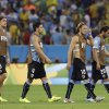 Photo - Uruguay's Diego Forlan (10) and his teammates leave the pitch following Colombia's 2-0 victory over Uruguay during the World Cup round of 16 soccer match between Colombia and Uruguay at the Maracana Stadium in Rio de Janeiro, Brazil, Saturday, June 28, 2014.  (AP Photo/Matt Dunham)