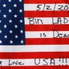 This is a flag placed at the temporary memorial to United Flight 93 in Shanksville, Pa., on Monday, May 2, 2011. Osama bin Laden, the face of global terrorism and architect of the Sept. 11, 2001, attacks, was killed in a firefight with elite American forces in Pakistan on Monday, May 2, 2011 then quickly buried at sea. (AP Photo/Gene J. Puskar) ORG XMIT: PAGP108