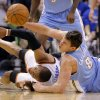 Oklahoma City\'s Russell Westbrook (0) and Denver\'s Danilo Gallinari (8) battle for a loose ball during the first round NBA playoff game between the Oklahoma City Thunder and the Denver Nuggets on Sunday, April 17, 2011, in Oklahoma City, Okla. Photo by Chris Landsberger, The Oklahoman