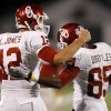 Oklahoma\'s Landry Jones (12) congratulates Ryan Broyles (85) after he caught a touchdown pass and set the NCAA receptions record during the college football game between the University of Oklahoma Sooners (OU) and the University of Kansas Jayhawks (KU) at Memorial Stadium in Lawrence, Kansas, Saturday, Oct. 15, 2011. Photo by Bryan Terry, The Oklahoman