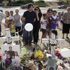 Actor Christian Bale, center, left, and his wife Sibi Blazic visit a memorial to the victims of Friday\'s mass shooting, Tuesday, July 24, 2012, in Aurora, Colo. Twelve people were killed when a gunman opened fire during a late-night showing of the movie