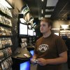 Andrew Smith, 19, of Edmond, Okla., plays the new Star Wars video game at Play N Trade in the Shoppes on Broadway at 33rd and Broadway, Tuesday, Sept. 30,2008, in Edmond, Okla. BY SARAH PHIPPS, THE OKLAHOMA