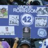 Young fans pay tribute to Jackie Robinson prior to a MLB baseball game between the Seattle Mariners and the Oakland Athletics, Sunday, April 15, 2012, in Seattle. (AP Photo/Ted S. Warren)
