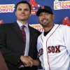 Boston Red Sox new outfielder Shane Victorino, right, shakes hands with general manager Ben Cherington during an introductory baseball news conference at Fenway Park in Boston, Thursday, Dec. 13, 2012. (AP Photo/Elise Amendola)