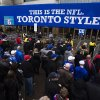 Photo - Fans enter the Rogers Centre before the Buffalo Bills play the Atlanta Falcons in NFL football action in Toronto, Sunday Dec. 1, 2013. (AP Photo/The Canadian Press, Mark Blinch)