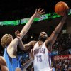 Oklahoma City\'s James Harden (13) shoots against Dallas\' Dirk Nowitzki (41) during the NBA basketball game between the Oklahoma City Thunder and the Dallas Mavericks at Chesapeake Energy Arena in Oklahoma City, Monday, March 5, 2012. The Thunder won, 95-91. Photo by Nate Billings, The Oklahoman