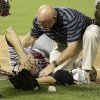 Atlanta Braves\' Tim Hudson is helped by a trainer after being injured on a play at first base during the eighth inning of a baseball game against the New York Mets, Wednesday, July 24, 2013, in New York. (AP Photo/Frank Franklin II)