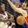 Photo - Chicago Bulls guard Nate Robinson, left, passes against Detroit Pistons guard Jose Calderon during the first half of an NBA basketball game in Chicago, Sunday, March 31, 2013. (AP Photo/Nam Y. Huh)