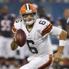 Photo - Cleveland Browns quarterback Brian Hoyer (6) scrambles as he looks for a receiver during the first half of a preseason NFL football game against the Chicago Bears, Thursday, Aug. 29, 2013, in Chicago. (AP Photo/Charles Rex Arbogast)