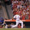Los Angeles Angels\' Albert Pujols hits into a double play during the first inning of baseball game against the Kansas City Royals, Friday, April 6, 2012, in Anaheim, Calif. (AP Photo/Mark J. Terrill)