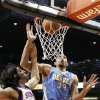 Phoenix Suns\' Luis Scola (14), of Argentina, and Denver Nuggets\' JaVale McGee (34) watch as the ball goes through the net for a score in the first half of an NBA basketball game, Monday, Nov. 12, 2012, in Phoenix. (AP Photo/Ross D. Franklin)