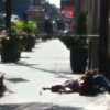Photo -   A body lies on the sidewalk near the Empire State Building after a shooting, Friday, Aug. 24, 2012, in New York. At least four people were shot and the gunman was dead, New York City officials said. A witness said the gunman was firing indiscriminately. (AP Photo/Gina Abdy)
