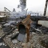 A mailbox is all that remains of one of four mobile homes which were destroyed in a gas fire Sunday, Aug. 24, 2014, at the Napa Valley Mobile Home Park, in Napa, Calif. A large earthquake caused significant damage and left at least three critically injured in California\'s northern Bay Area early Sunday, igniting fires, sending at least 87 people to a hospital, knocking out power to tens of thousands and sending residents running out of their homes in the darkness. (AP Photo/Ben Margot)