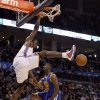 Oklahoma City\'s Serge Ibaka (9) dunks the ball over Golden State\'s Ekpe Udoh (20) during the NBA basketball game between the Oklahoma City Thunder and the Golden State Warriors at the Oklahoma City Arena, Tuesday, March 29, 2011. Photo by Bryan Terry, The Oklahoman