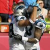 Photo - Carolina Panthers tight end Greg Olsen (88) is congratulated by teammate Louis Murphy (83) after his touchdown during the first half of an NFL football game against the Kansas City Chiefs at Arrowhead Stadium in Kansas City, Mo., Sunday, Dec. 2, 2012. (AP Photo/Colin E. Braley)