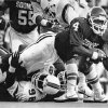 Photo - OU COLLEGE FOOTBALL: University of Oklahoma freshman quarterback Jamelle Holieway had limited success against Miami in 1985.    OKLAHOMAN ARCHIVE    ORG XMIT: 0709032201572674