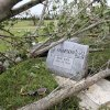 A large tree limb, toppled by Monday night\'s tornado, removed this headstone from its base on a grave in Earlsboro Cemetery on Highway 9A in Pottawatomie County. Photo taken Wednesday, May 12, 2010. Many headstones in the cemetery were knocked over when the twister crossed through the area. Photo by Jim Beckel, The Oklahoman