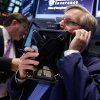 Photo - Trader Christopher Fuchs, right, works on the floor of the New York Stock Exchange, Friday, May 23, 2014. Stocks inched higher early Friday in quiet trading ahead of the Memorial Day weekend.  (AP Photo/Richard Drew)