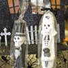 Photo - Skeleton bride and groom candlesticks are sold at Scruples of Edmond. Photo by David McDaniel, The Oklahoman