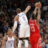 Oklahoma City \'s Russell Westbrook (0) blocks a shot by Houston\'s James Harden (13) during the NBA basketball game between the Houston Rockets and the Oklahoma City Thunder at the Chesapeake Energy Arena on Wednesday, Nov. 28, 2012, in Oklahoma City, Okla. Photo by Chris Landsberger, The Oklahoman