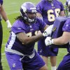 Minnesota Vikings tackle Phil Loadholt, left, a second-round draft pick, goes through drills during the Vikings\' minicamp Friday, May 1, 2009, in Eden Prairie, Minn. (AP Photo/Jim Mone) ORG XMIT: MNJM102
